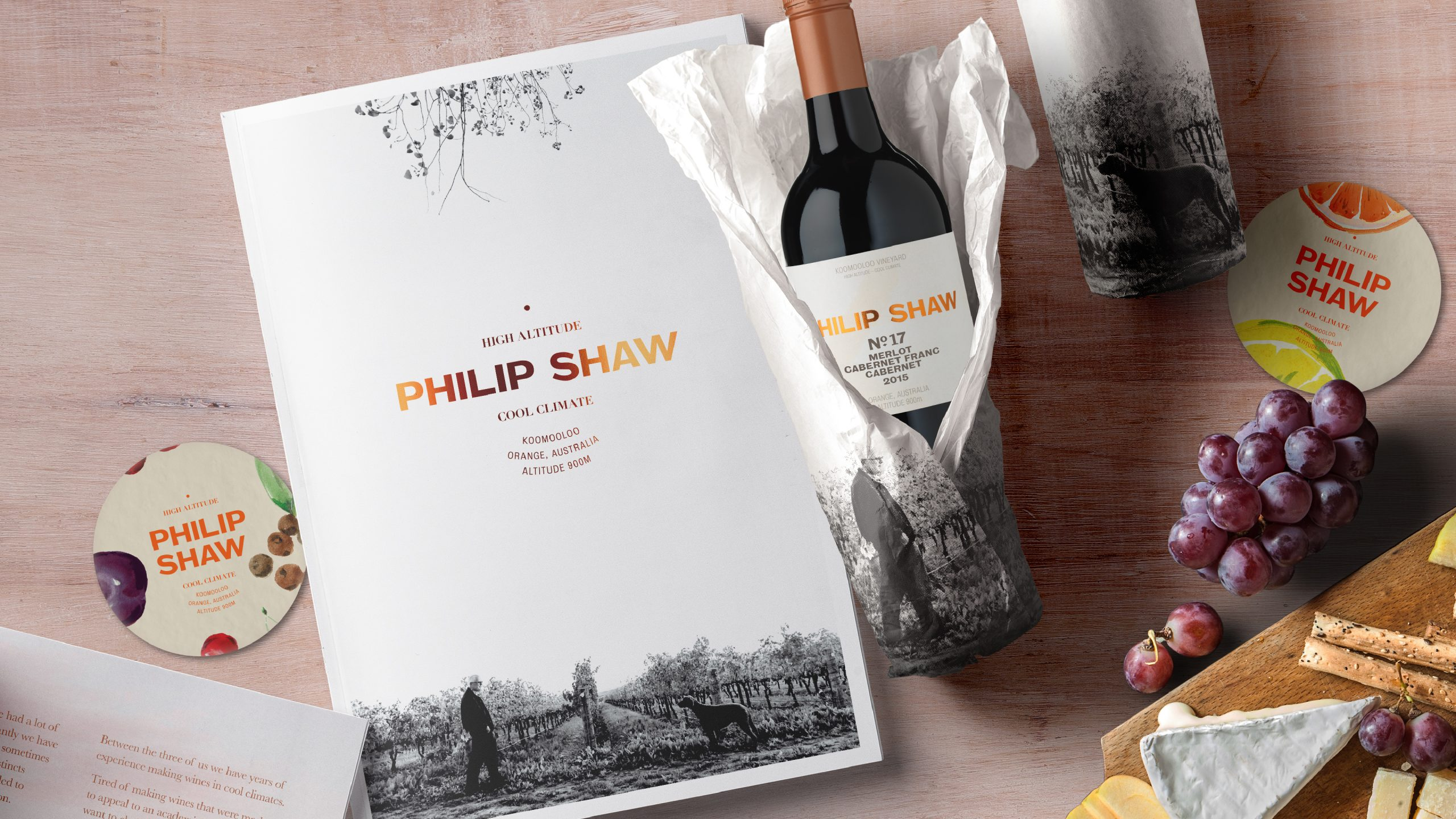 Philip Shaw Wines products arranged on a bench top with grapes and a chessboard. Image highlights the brand and packaging designed by Helium Design Melbourne.